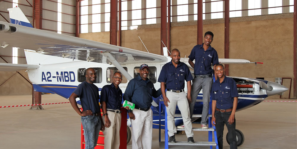 Major Blue maintenance personnel in the very large new hangar