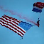 Night parachute jump with US flag