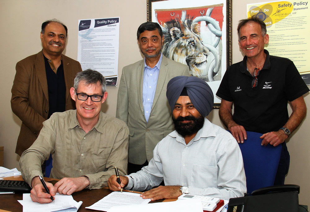 Signing the deal for the first Airvan GA-10