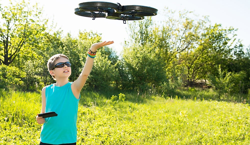 Child with quadcopter drone