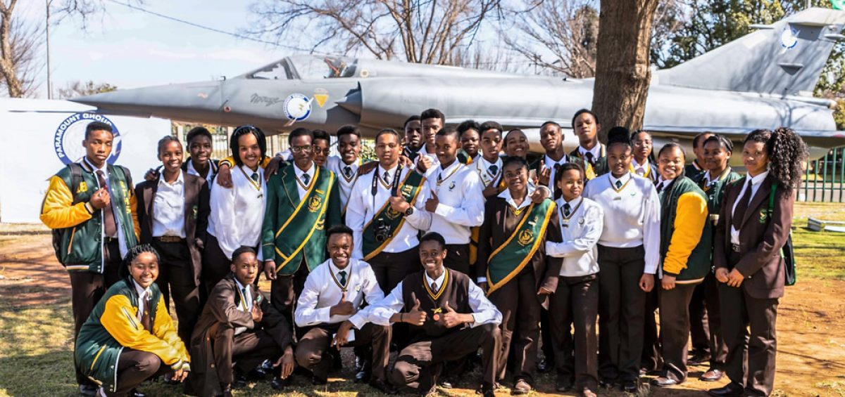 Learners in front the Mirage III at Rhodesfield Technical High School