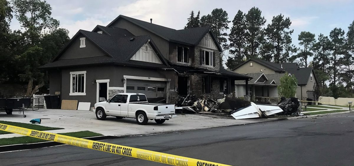 Pilot crashes bizjet into house