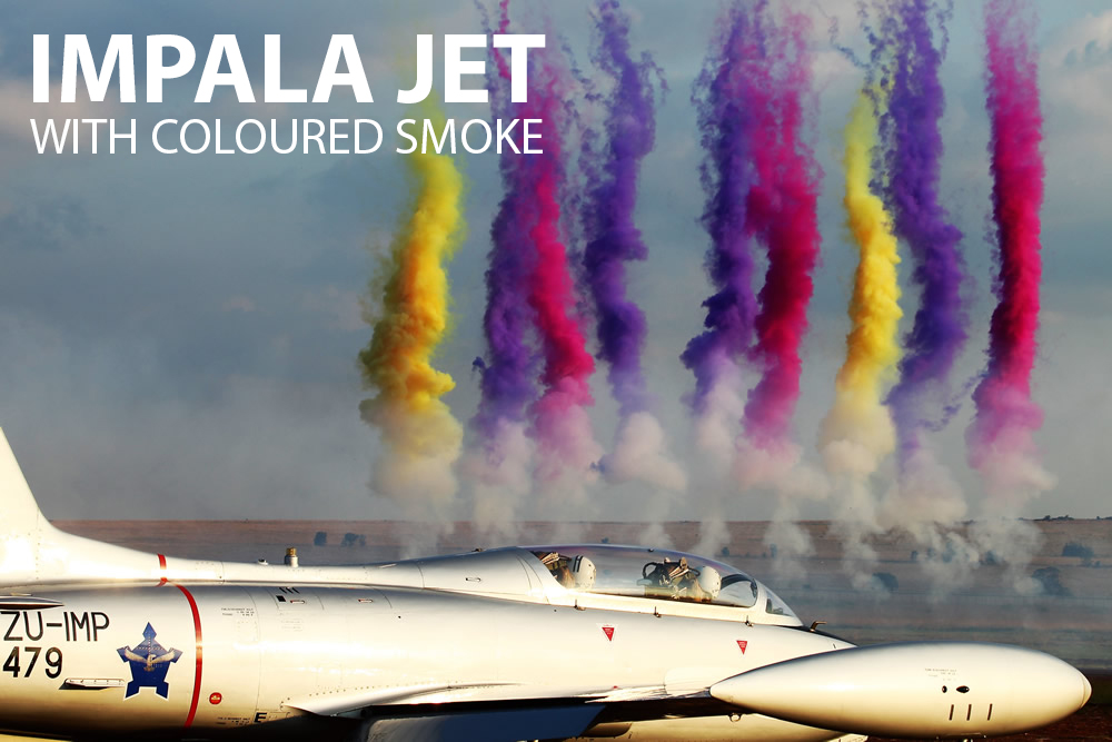 Impala Jet with coloured smoke in the background taken at Middelburg on Saturday
