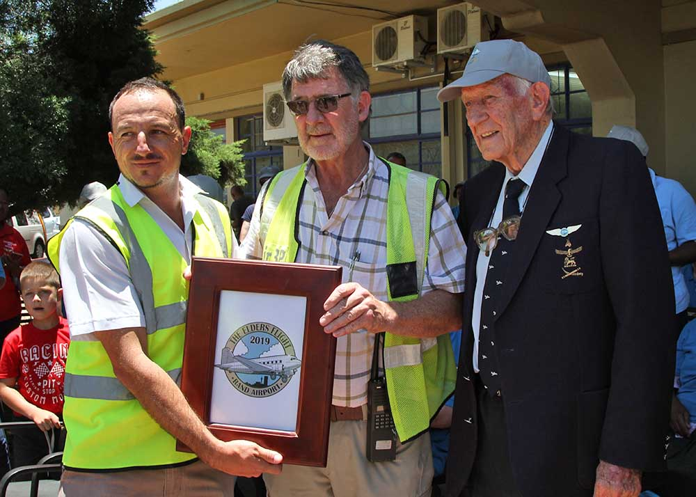 Hand over of plaque to Rand Airport manager