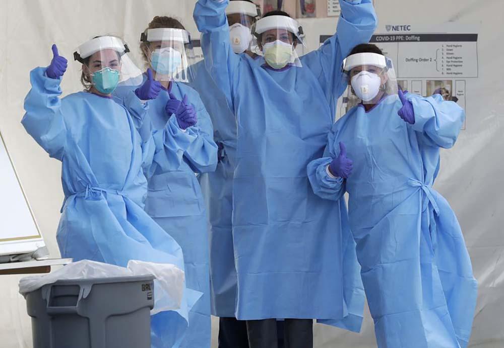 Flight attendants in protective gear