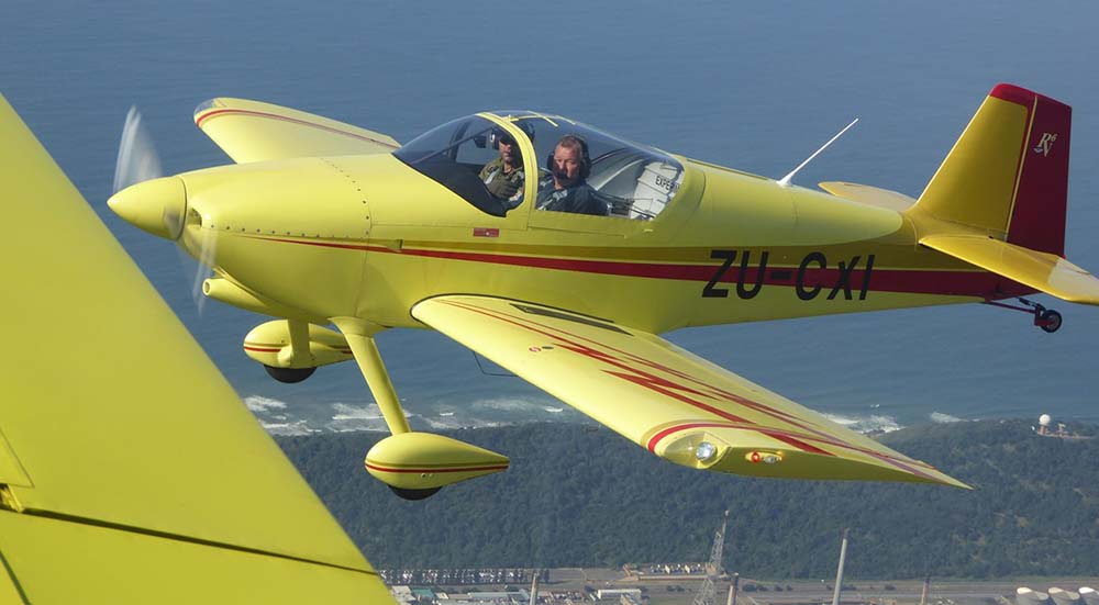 It is my partner Rob Beach flying with Steve Isaacson as instructor. I am the photographer. We last met in 2013 when we were at Oshkosh with the SA group.Currently building a Steen Skybolt - aerobatic bi-plane.